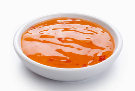 Orange sweet and sour sauce in the white bowl Stock Photo