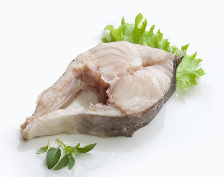 stake: Fried stake of cod with fresh green lettuce on the white plate