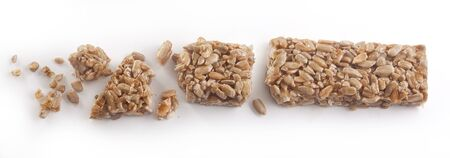 snack bar: Some pieces of brittle on the wooden board Stock Photo
