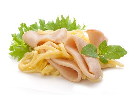Some squid rings with pasta, fresh green lettuce and basil