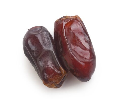 white sugar: Isolated two dates covered with sugar syrup on the white background