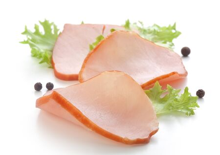 pork  loin: Three pieces of pork loin with fresh green lettuce and black pepper