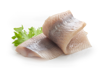 lettuce: Two pieces of salted herring with fresh green lettuce on the white plate Stock Photo