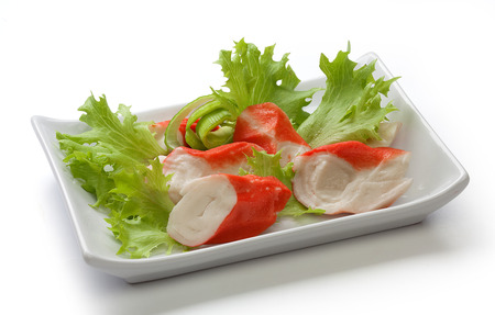 Crab meat with fresh green lettuce on the plate Stock Photo