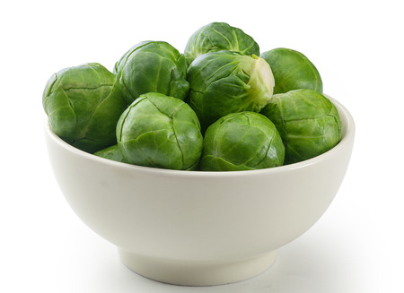 Handful of fresh green brussels sprouts in the bowl Stock Photo