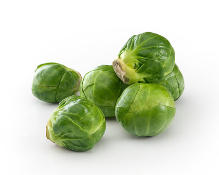brussels sprouts: Handful of fresh green brussels sprouts on the white