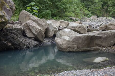 Mountain river blocked by stones in the Caucasus