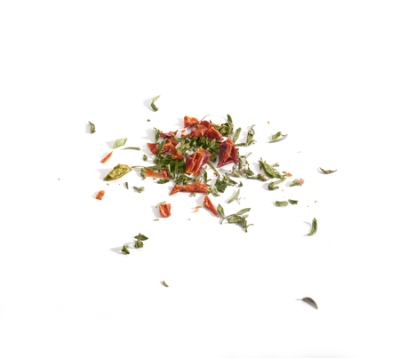 Dried red and green herbs on the white background