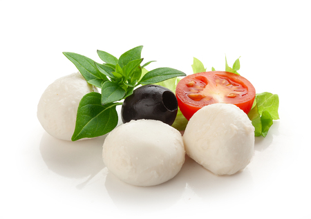 Some balls of mozzarella with half of tomato cherry, black olives and green basil