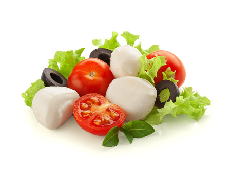 Some balls of mozzarella with tomato cherry, olives and fresh green lettuce