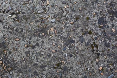 Concrete surface with pebble inclusions Фото со стока