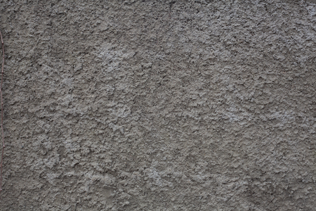 Fragment of gray cement coated wall Фото со стока