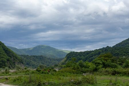 Ashe mountain river valley at the cloudy summer day