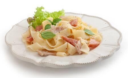 Isolated pasta carbonara on the white plate
