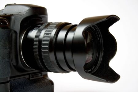 telezoom: reflex digital camera on a white background