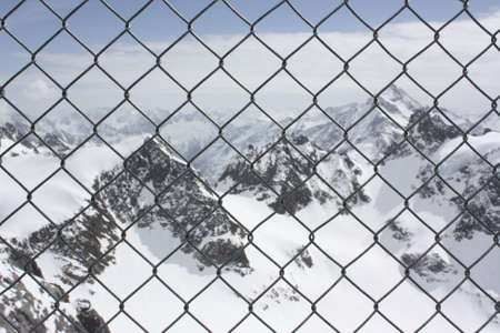 fencing wire: Fencing Wire at Snowy Mountain Stock Photo