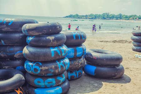 inner tube: Piles of inner tube on the beach