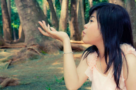 Beautiful young asian girl model blow her hand close up Stock Photo
