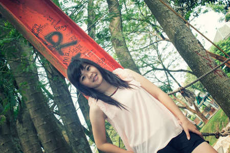 bridge in nature: Beautiful young asian girl model leaning at the pole bridge Stock Photo