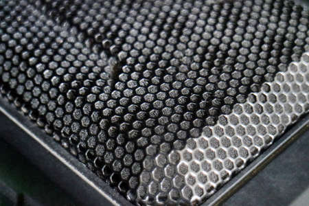 Black metal computer case panel mesh with holes