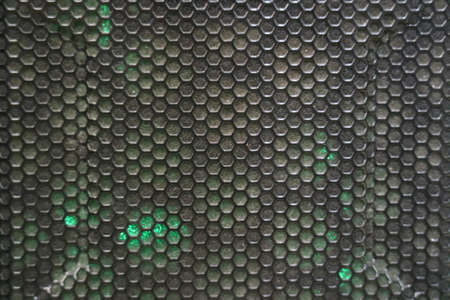 Black computer case panel mesh with holes Stock Photo