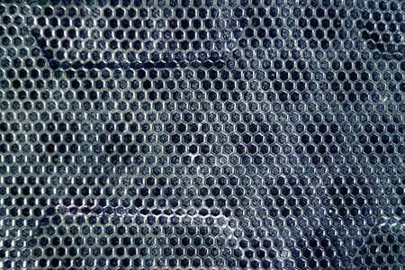 Black Computer Case panel with Black Holes Stock Photo