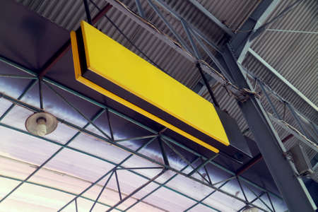 Yellow Empty Signage Hanging in Station with Iron Frame Stock Photo