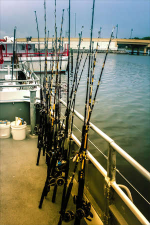 Rods are on the deck of a boat, all ready for sea fishing. Copy paste.