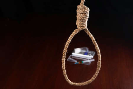 The noose hanging from the ceiling which are drugs.