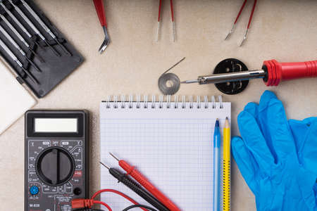 Multimeter, soldering tool and hand tools for electronics assembly. Copy space. Archivio Fotografico