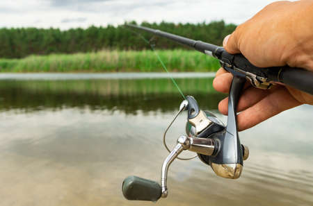 Spinning fishing is an exciting activity. Sport fishing.
