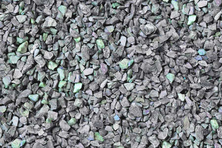 Grey gravel pile closeup photo for background. Grey stones bunch for wallpaper or banner template. Natural texture Banco de Imagens