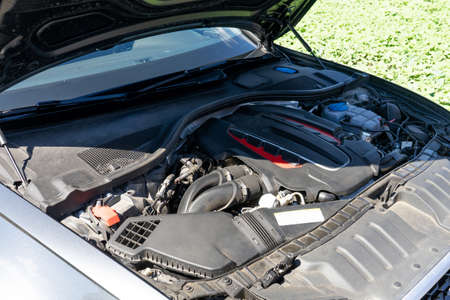 The engine of the modern car, the bonnet is open. Copy paste