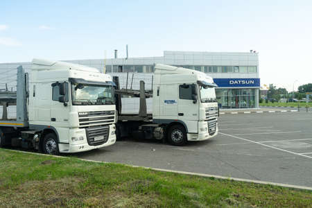 Belgorod, Russia, July 29, 2018: Two trucks. cars are parked near the dealership.
