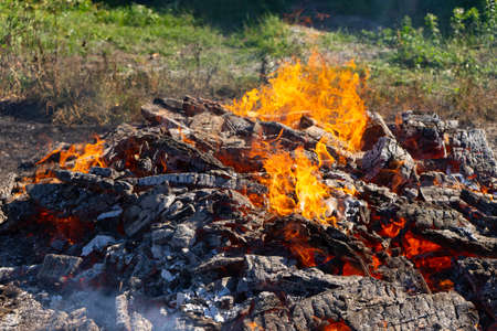 A large fire burning in the open Stock Photo