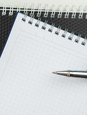 Design concept . Spiral notebook and ballpoint pen on white background for mock up