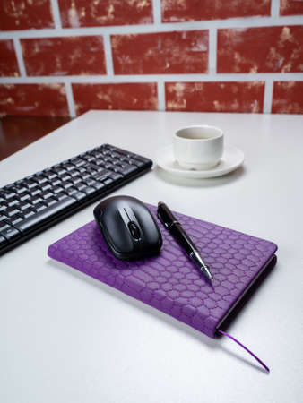Office table desk. Workspace with note book, keyboard, office supplies and coffee cup on white background. Banco de Imagens