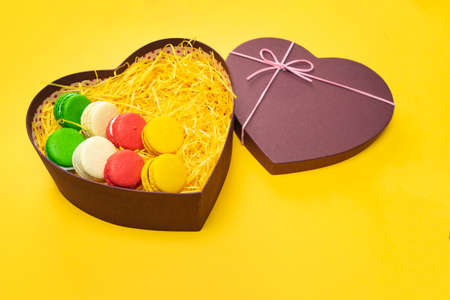 Macaroons in a gift box. Heart-shaped box.
