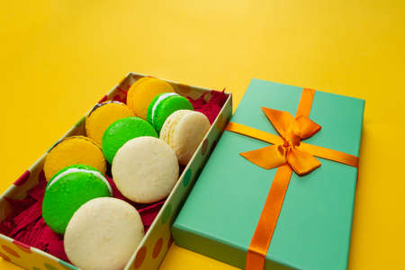 Colorful macaroons. Sweet macaroons on color background with copy space.