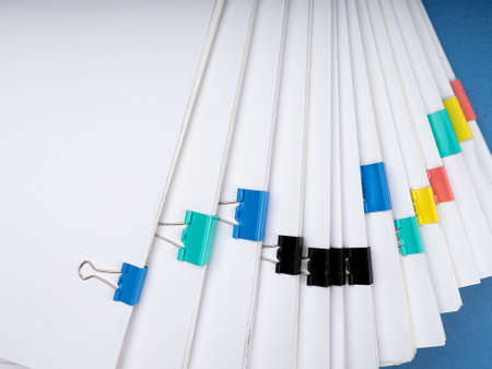 Mock up, stack of papers documents in archives files with paper clips on desk at offices, business concept. Copy space.