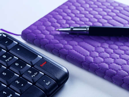 Office desk table with computer keyboard and supplies. On white background. Copy space.