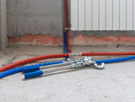 Plumbing copper pipe crimper press tube tool. Heating pipes connected by press fittings. Hydraulic, tools for plumber