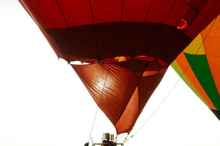 Fire warms the air in a balloon. Balloonists prepare the balloons for flight. Festival of aeronautics