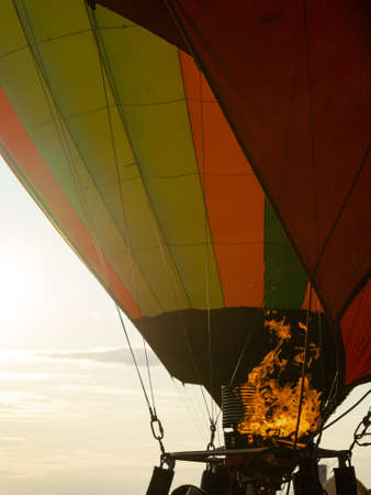 Fire warms the air in a balloon. Balloonists prepare the balloons for flight. Festival of aeronautics.