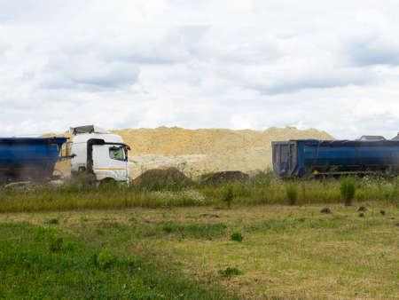 Dump Trucks carry sand for road construction