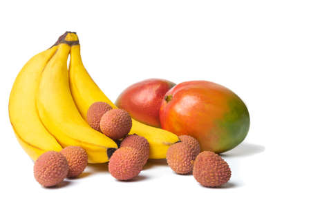Litchi, bananas and mangoes, exotic fruits on a white background