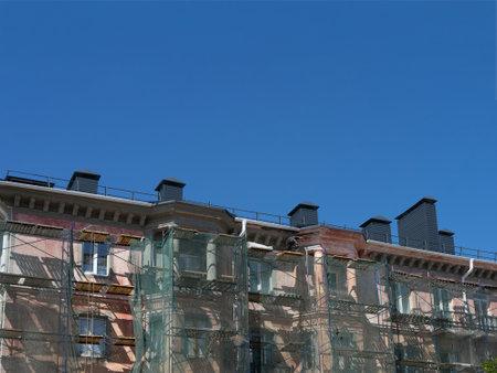 Scaffolding around a building, renovating facade building 版權商用圖片