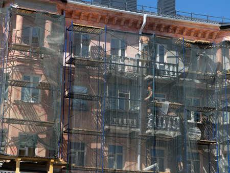 Scaffolding around a building, renovating facade building.
