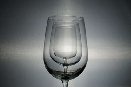 back lit: Three back lit wine glasses in a row