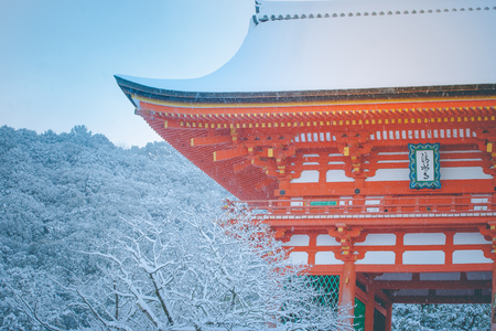 Beautiful winter seasonal image, corner of Red Pagoda at Kiyomizu-dera temple covered white snow with blue sky background at Kyoto, Japan. 版權商用圖片